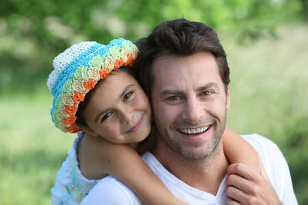 father daughter: Daughter on Father Stock Photo