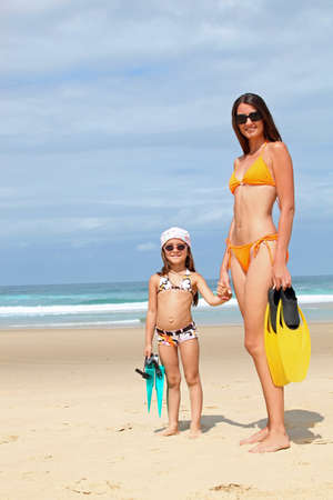 Mother and daughter at the beach. photo