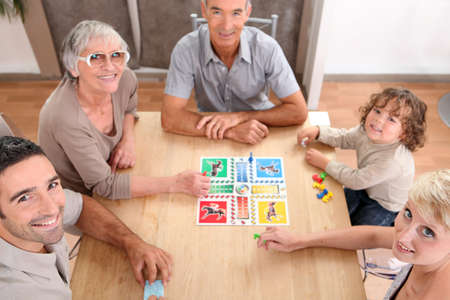 board games: Family playing board games.