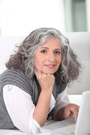 Older woman surfing the internet photo