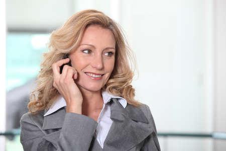 blonde close up: Confident businesswoman on phone