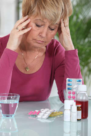 Woman sat in front of medication photo