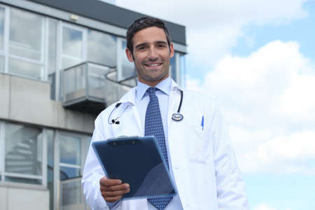 dietitian: Doctor standing outside a hospital Stock Photo
