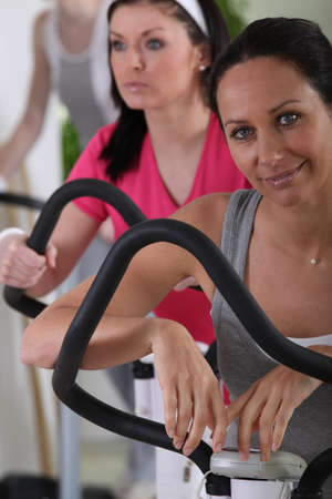 Women using exercise equipment in a gym Stock Photo - 11824257