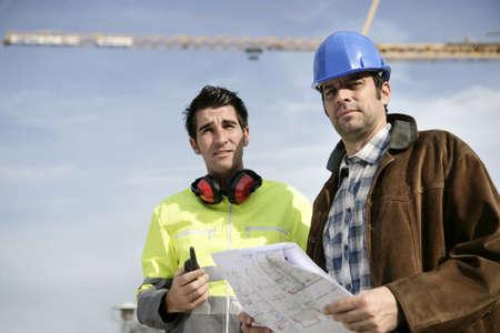 traffic warden: A surveyor and a traffic warden Stock Photo