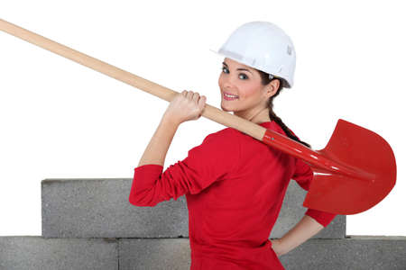Female construction worker with a shovel photo