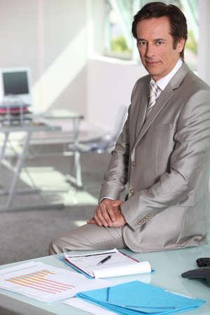finance director: Businessman sat on table