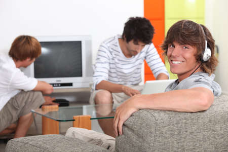 accommodation: Three lads relaxing at home Stock Photo