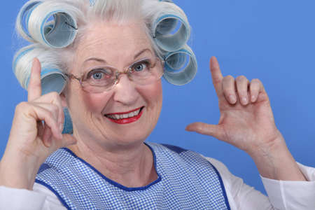 rollers: Granny with her hair in rollers Stock Photo