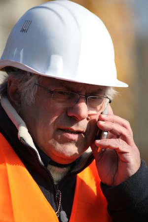 obrero: Forman hacer llamadas de teléfono Foto de archivo