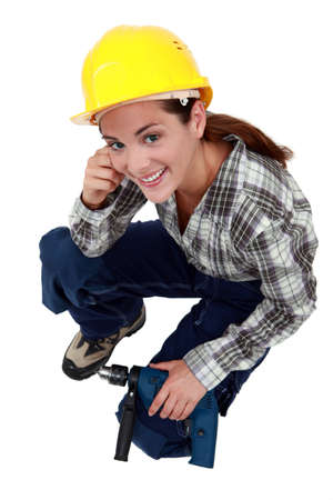 female construction worker: A female construction worker with a drill. Stock Photo