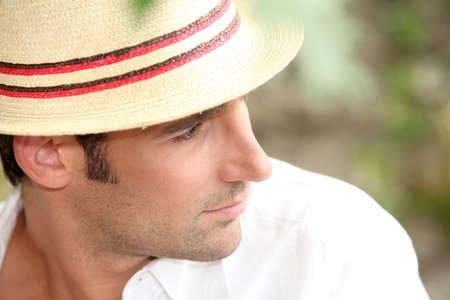 head wear: Man wearing a straw hat
