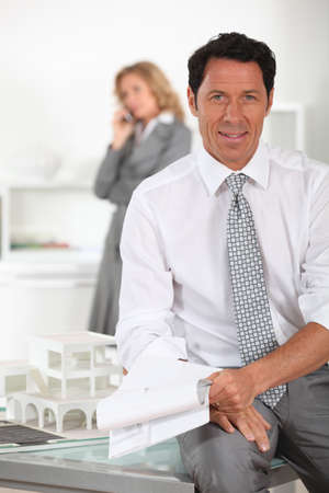 under paid: Architect and assistant Stock Photo