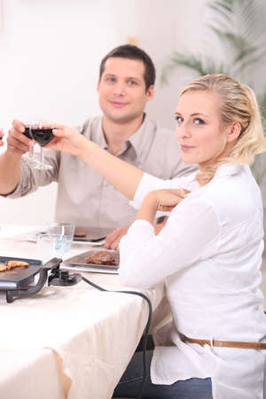 Couple eating meal at home photo
