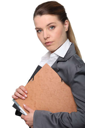 Young businesswoman holding folder photo