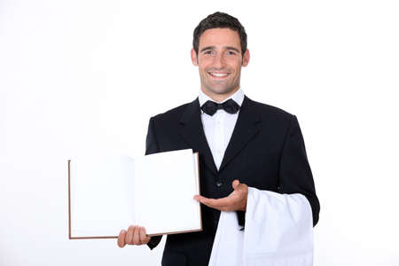 Waiter presenting menu photo