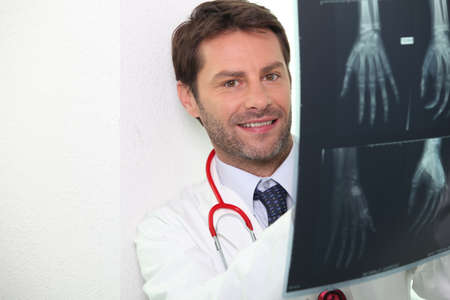dark haired: portrait of a doctor with radiography