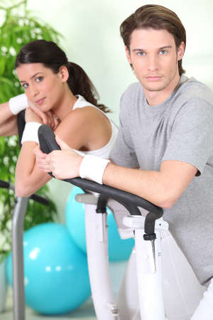 Couple exercising in gym photo