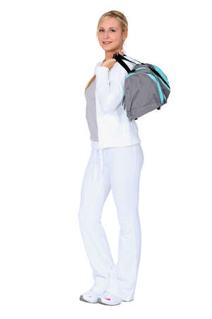 Woman with gym bag photo