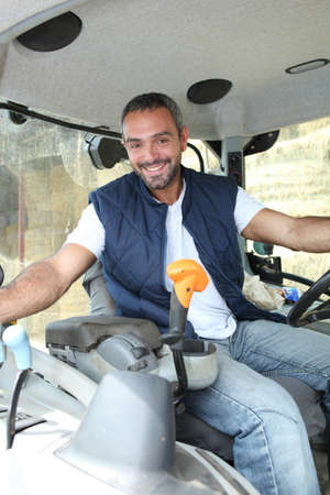 agricultural life: Farmer in the cab of his tractor