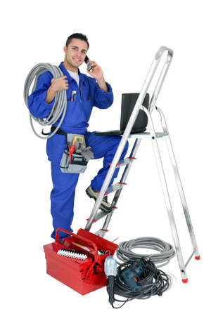30 to 35: Electrician with mobile telephone