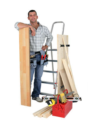 Carpenter with floorboards photo