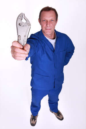 Laborer holding wrench photo