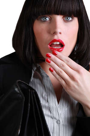Woman with her hand to her mouth in shock Stock Photo - 11824879