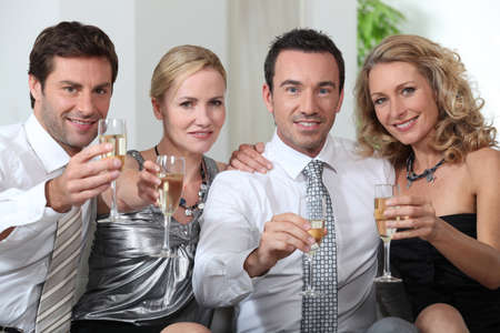Colleagues drinking a glass of champagne Stock Photo - 11825599