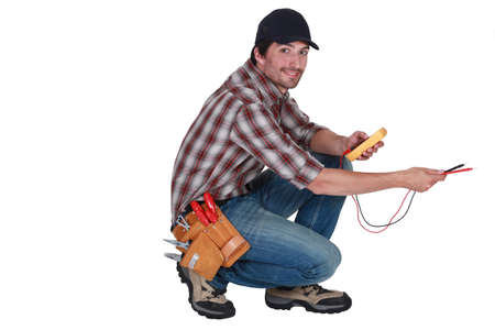 voltmeter: electrician holding a measurement tool Stock Photo