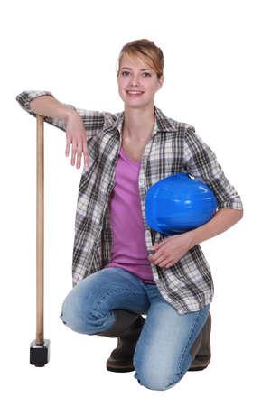 kneeling woman: craftswoman posing