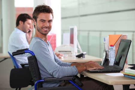 Man in wheelchair on laptop Stock Photo - 11842816