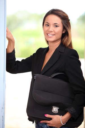 Woman opening her front door photo