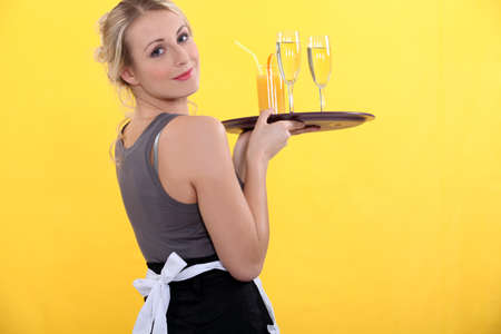 blonde waitress bringing orange juice photo