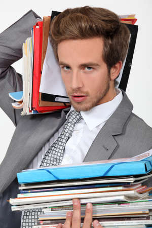 Man overwhelmed by files Stock Photo - 11842525