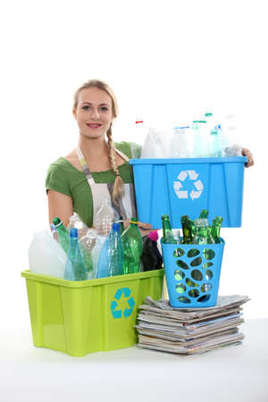 A woman recycling plastic bottles. photo