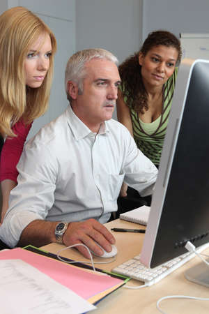 capable of learning: teacher and students working together Stock Photo