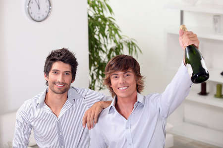 Guys with a bottle of champagne Stock Photo - 11842657