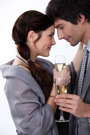 Elegant young couple drinking champagne