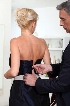 Man closing zipper  of his wife Stock Photo