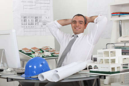 Happy architect in his office photo
