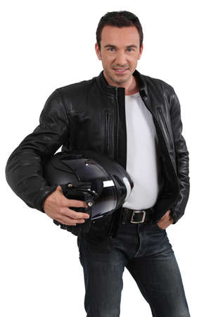 leather glove: Biker holding helmet Stock Photo