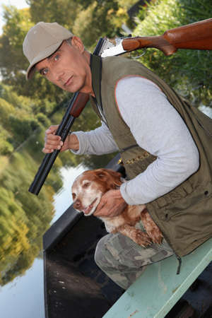 senior hunting with his dog photo