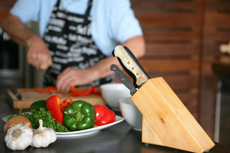 man cutting vegetables Stock Photo - 11842840