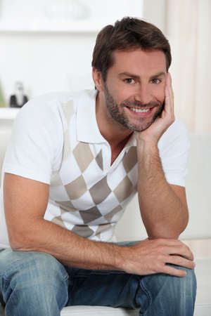 35 years: Smiling man relaxing at home Stock Photo