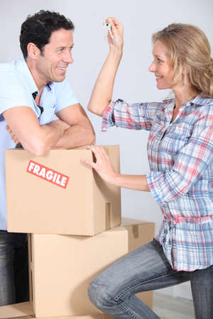 40 45: Couple with boxes smiling