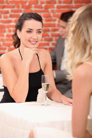 enraptured: girls in a restaurant Stock Photo