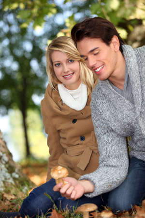 Couple picking mushrooms together Stock Photo - 11842615