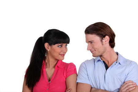 Young couple flirting in a studio photo