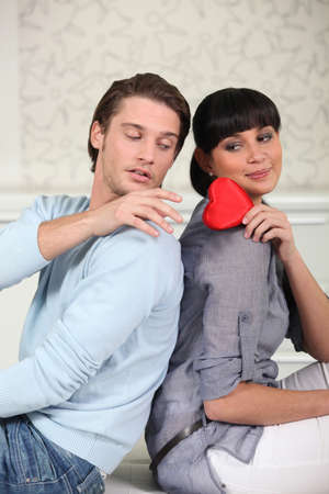 20 24 years old: Young woman giving her heart to a man Stock Photo